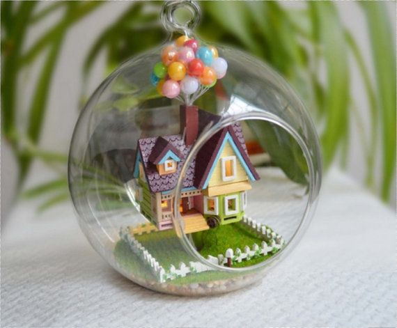 up house in glass ball
